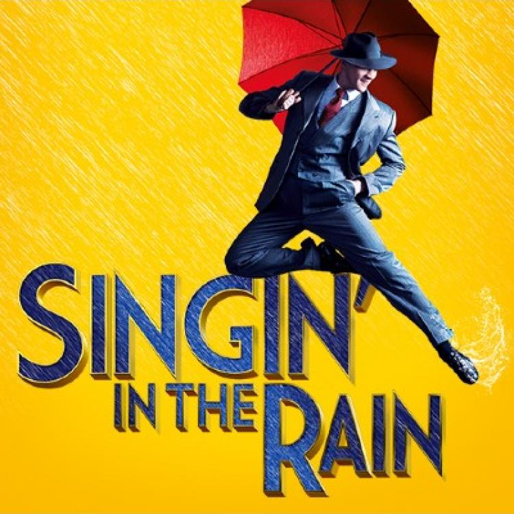 Singing in the rain text and man with umbrella